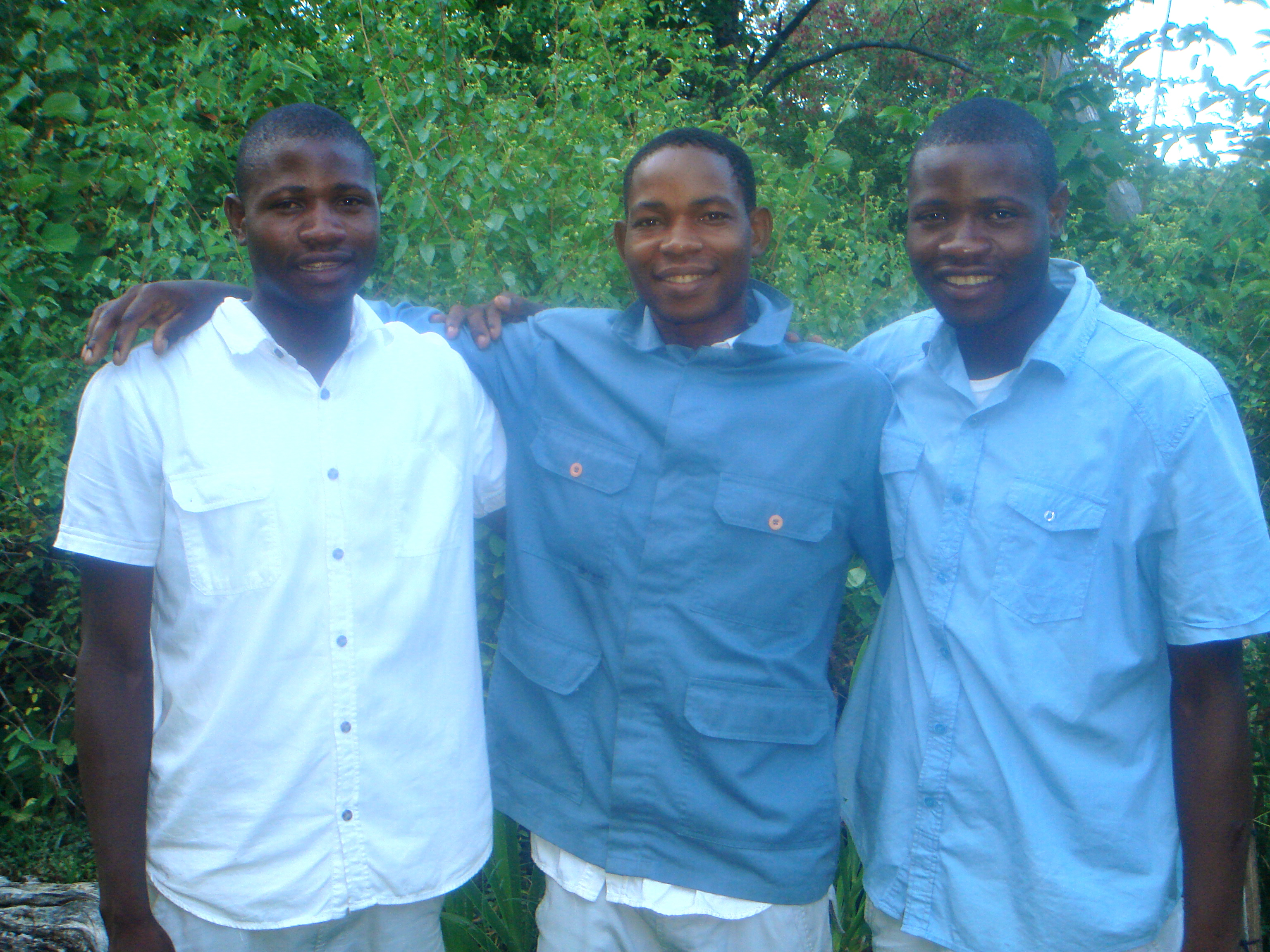 River Dance Lodge's three managers from neighboring village.