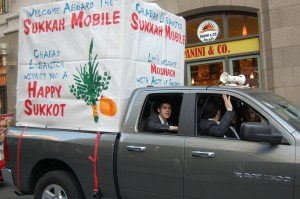 Lubavitchers and their Sukkot Mobile parked across from Zuccotti Park. Photo by Cathleen Falsani/Sojourners