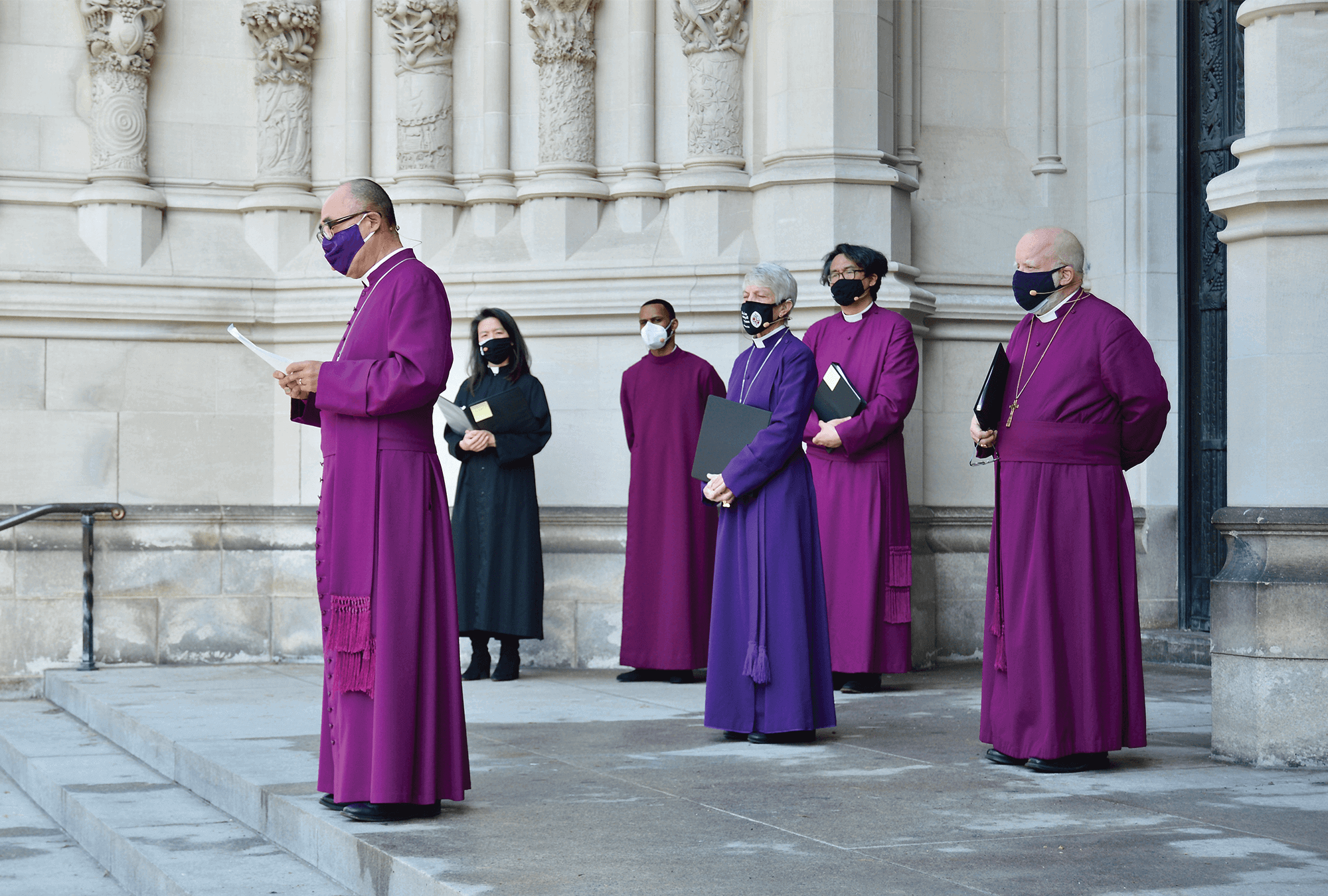Photo of a gathering of Episcopal leaders outside St. John the Divine Cathedral.