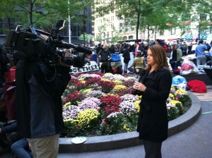 A TV reporter broadcasts from the NY protests last week/Photo by Tim King for Sojourners