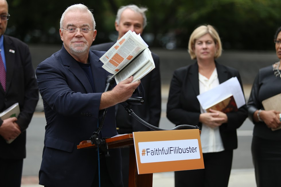 Photo of Jim Wallis at #faithfulfilibuster with poverty bible