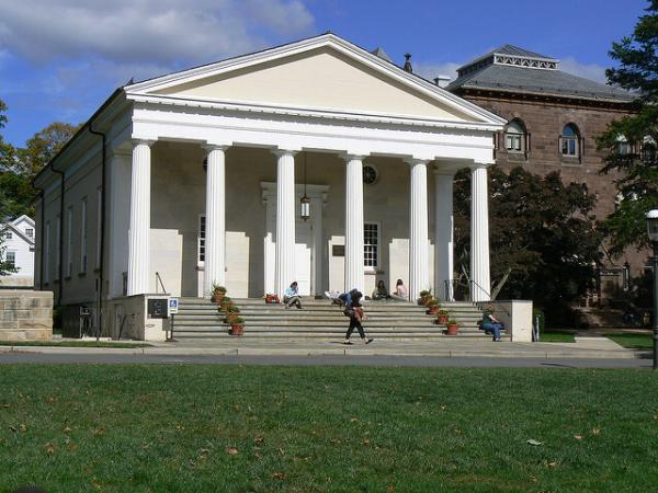 An photo of students walking past Miller Chapel on Princeton Seminary's campus