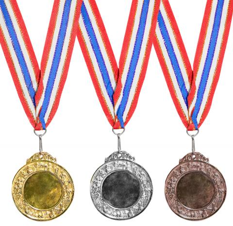 Gold, silver, and bronze medals. Image Source / Getty Images
