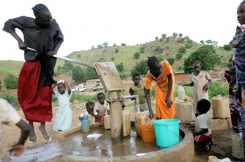 Sudanese residents pump water from a well in their village in the South  Kordofan region. ASHRAF SHAZLY AFP Getty Images ecdbe237f