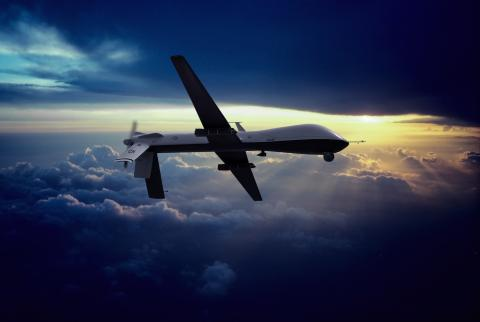 MQ 1 Predator Unmanned Drone With Hellfire Missiles Flying At Sunset Erik Simonsen Getty Images