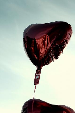 Red heart balloon. Image via Wylio, http://bit.ly/yctzSw.