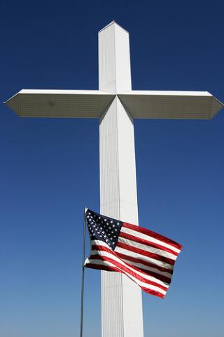Cross and Flag. Image via Wylio http://bit.ly/rU6OGA