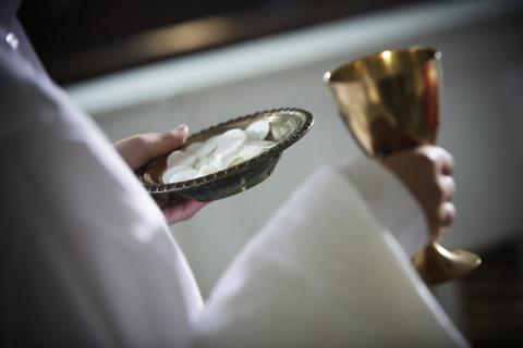 Close up of communion wafers and chalice, Ron Koeberer / Getty Images