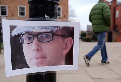 Bradley Manning photo hangs on lightpost, photo by savebradley / Flickr.com