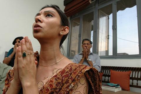 A woman chanting at Bharat Soka Gakkai. Image by The India Today Group/Getty Ima