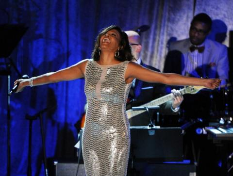 Whitney Houston performs onstage during the 2011 Pre-Grammy Gala. Photo by Getty