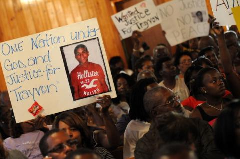Residents attend to a town hall meeting 2/20 to discuss Martin's slaying. Getty