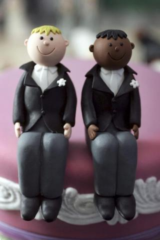 Wedding cake topper photo by Christopher Furlong/Getty Images.