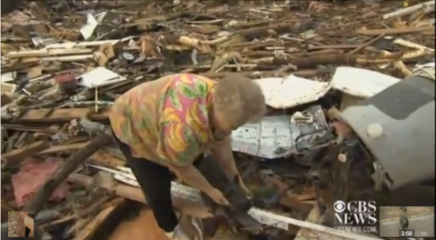 Screenshot of woman who found her dog amid tornado rubble in Moore, Okla.