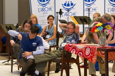 Co-chairs of L'Arche USA's inclusion team dramatize the founding of L'Arche. Ima