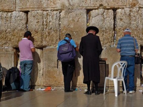 Tourists pray at the Wailing Wall in Jerusalem. Via Wylio http://bit.ly/wsudSt.