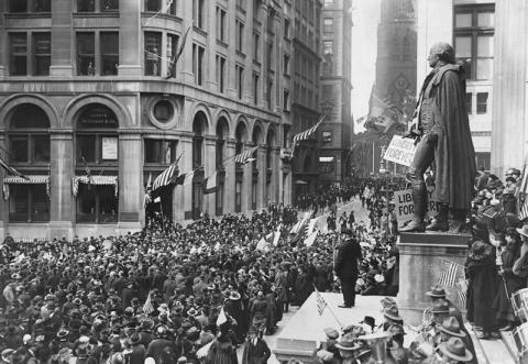 Crowds gather at the Subtreasury building on Wall Street for Armistice Day 1918