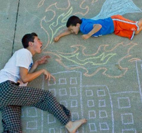 The chalk drawing by Wes Noyes, 17, with his superhero brother, Jonah, 8.