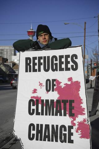 Demonstrator at a climate change rally in Calgary, Canada, 2007. Image via Wylio