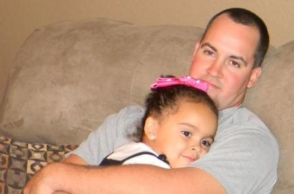 Veronica with her father Dusten Brown. Photo courtesy RNS/Keep Veronica Home web
