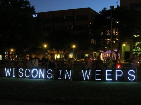 The Overpass Light Brigade at the prayer vigil in Milwaukee. Courtesy Steve Jerb