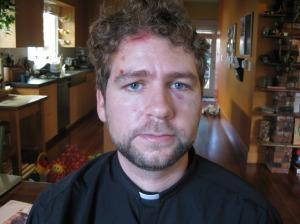 The Rev. John Helmiere, who was beaten by police during a nonviolent protest in
