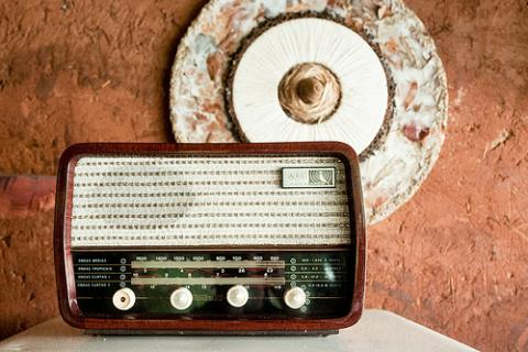Old radio, adobe wall. Image via Wylio http://bit.ly/zFgPqk