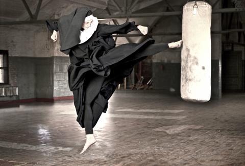 Nun kicks a heavy bag in a gym. Photo by Martin San/Getty Images.