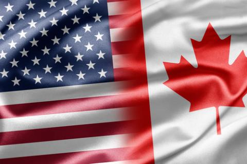 United States and Canadian flags,  ruskpp / Shutterstock.com