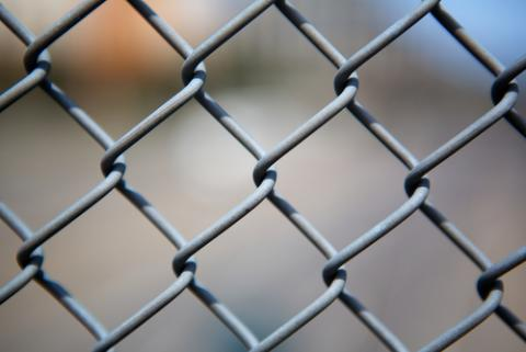 Chain link fence. Image courtesy Bobkeenan Photography / shutterstock.com.