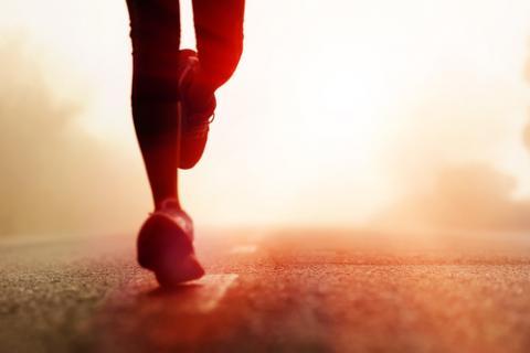 Silhouette of runner, Warren Goldswain / Shutterstock.com