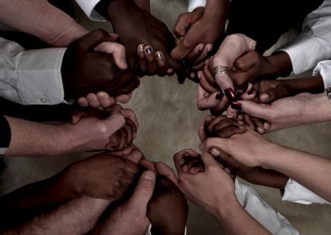 Hands held in a circle. Photo courtesy Brett Jorgensen/shutterstock.com