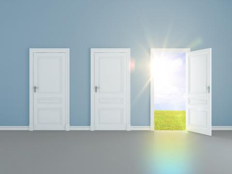 A door opens to light. Image courtesy Peshkova/shutterstock.com
