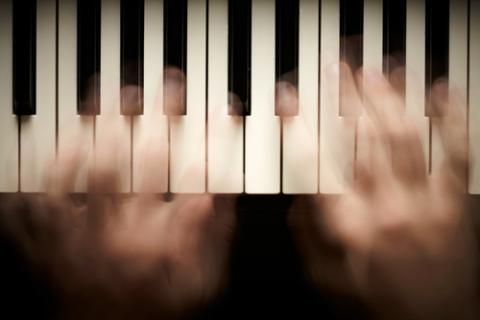 Photo: Hands playing piano, © silver-john / Shutterstock.com