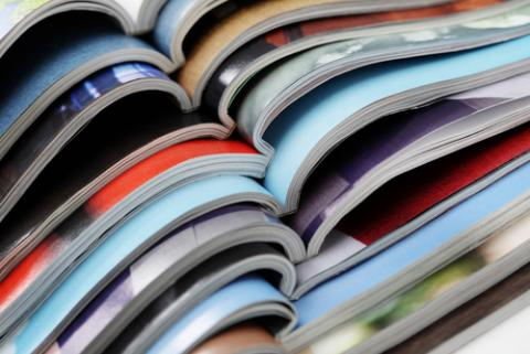 pile of magazines / Shutterstock.com