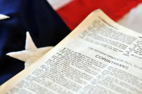Bible and flag, JustASC / Shutterstock.com