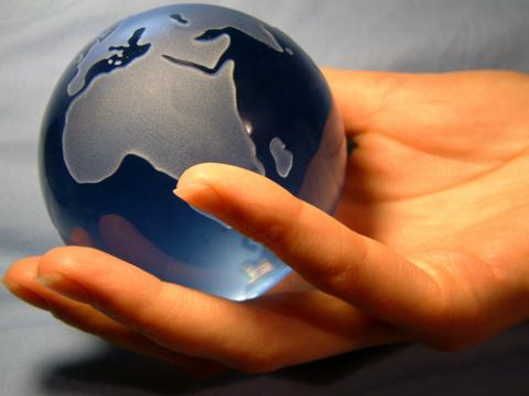 Globe in hand,  Magdalena Bujak / Shutterstock.com