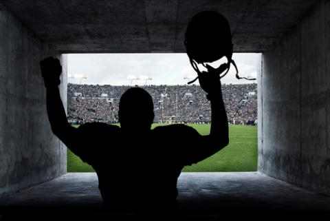Football player in a tunnel, Brocreative / Shutterstock.com