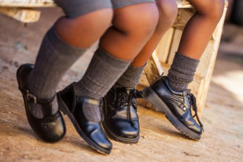Two schoolchildren wait for the bus, Nolte Lourens / Shutterstock.com
