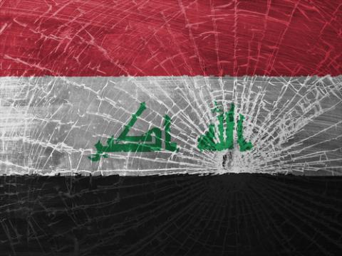 The Iraqi flag, shattered. Image courtesy MyImages - Micha/shutterstock.com