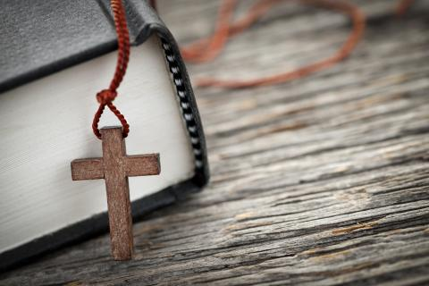 Cross & hymnal, Elena Elisseeva / Shutterstock.com