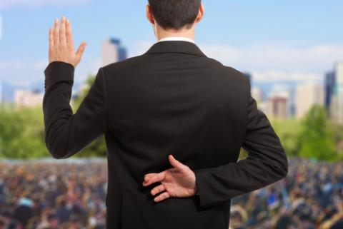 Politician swearing oath with fingers crossed, Minerva Studio / Shutterstock.com