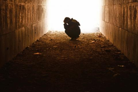 Child alone in a tunnel,  hikrcn / Shutterstock.com