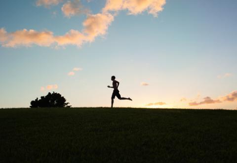 Silhouette of young man running, KieferPix / Shutterstock.com