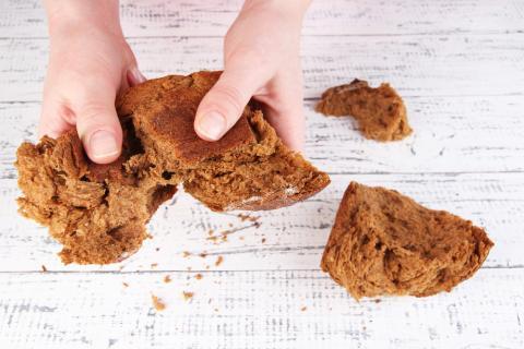 Breaking bread. Image via Africa Studio/shutterstock.com