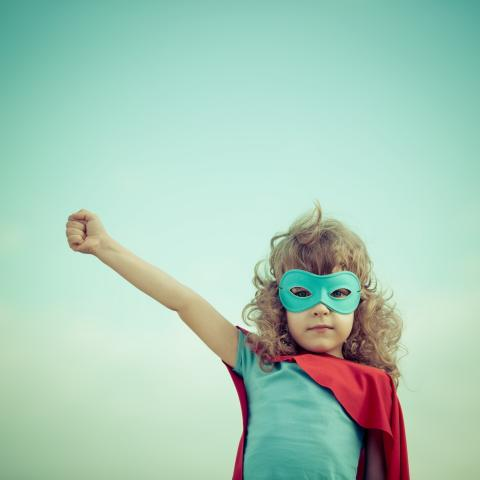 Girl dressed up like a superhero, Sunny studio / Shutterstock.com