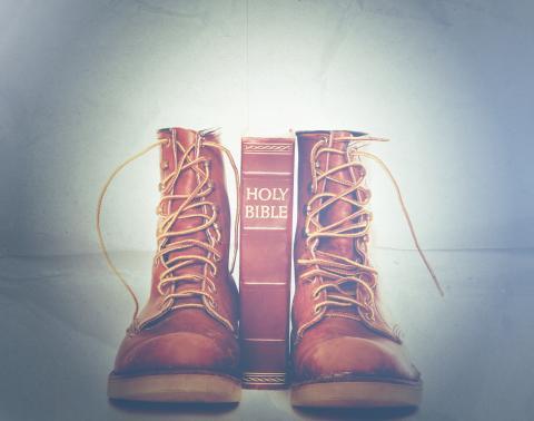 Bible and boots, Paul Matthew Photography / Shutterstock.com