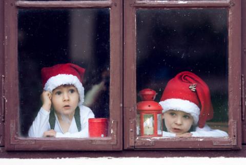 Two boys wait for Santa. Image courtesy Tomsickova Tatyana/shutterstock.com