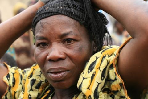 Refugees pass from DR Congo into Uganda in 2008, Sam DCruz / Shutterstock.com