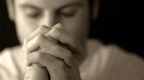 Man Praying, Kevin Carden/Shutterstock.com